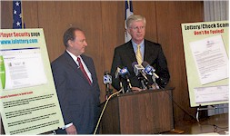 Iowa Attorney General Tom Miller (Right) and Iowa Lottery CEO Dr. Ed Stanek